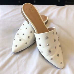 Faux leather studded flat mules.